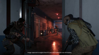 Two teammates stand at a doorway waiting for enemies to clear.