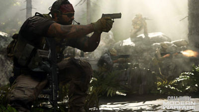 A lethal Modern Warfare Tier One Operator dressed in combat gear aims a pistol forward waiting to fire.