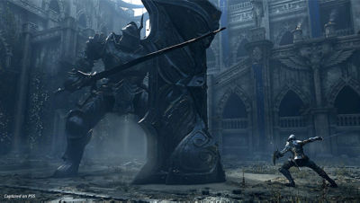 PS5 Demon's Souls screenshot showing the protagonist battling a giant knight monster with large shield.