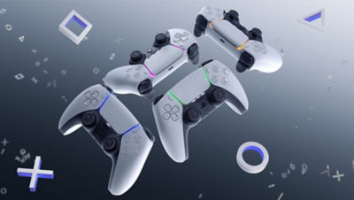 Image of 4 DualSense wireless PS5 controller together with the PlayStation logo
