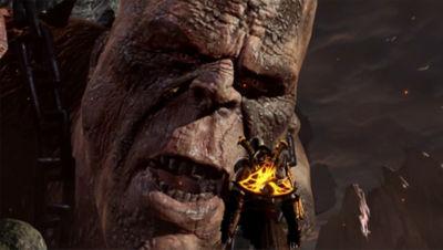 PS4 God of War 3 screenshot featuring Kratos facing and talking with a Titan