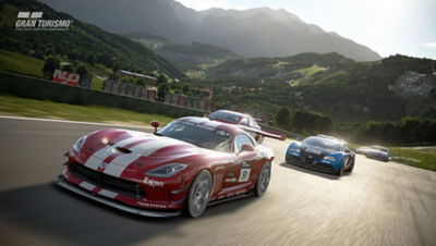 PS4 Gran Turismo Sport screenshot featuring cars racing on a track in the hills