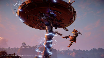 PS4 Horizon Zero Dawn Complete Edition screenshot featuring Aloy swinging from a Tallneck
