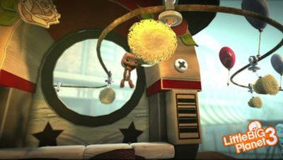PS4 Little Big Planet 3 screenshot featuring Sackboy swinging on a brush on a track