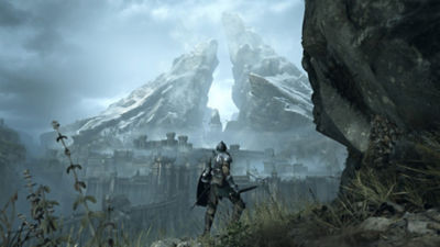 The main character of Demon's Souls faces a fog-laden castle stands atop a cliff and looks off into the fog-laden distance