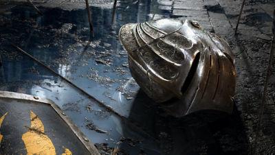 Demon's Souls protagonist's helmet shown laying on the floor.