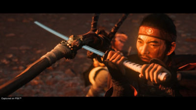Ghost of Tsushima Director's Cut Jin defends against an attack