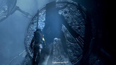 Image of Selene walking up to a stone monument