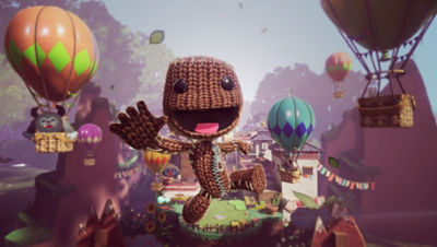 Image of Sackboy in the air with hot air ballons surrounding him