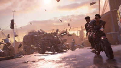 PS4 Uncharted 4 screenshot featuring Nathan Drake and Sam Drake on a motorcycle outrunning a truck with debris flying in the air