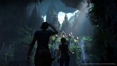 PS4 Uncharted The Lost Legacy screenshot featuring Chloe and Nadine looking at an ancient ruin