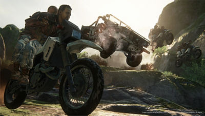 PS4 Uncharted The Lost Legacy screenshot featuring players racing in a Jeep and bikes on rocky terrain
