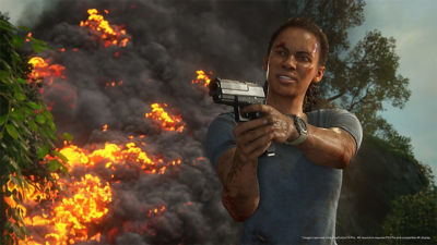 PS4 Uncharted The Lost Legacy screenshot featuring Nadine Ross holding a hand gun in front of a fire